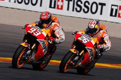 Repsol Honda's Marc Marquez and Dani Pedrosa at Valencia in 2015.