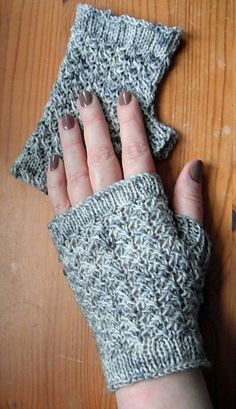 Free knitting pattern for Arya's Gauntlets - These fingerless mitts were designed by Julie Coburn with modified star stitch to resemble chain mail.