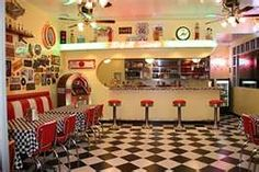 decorating 50' diner style  Notice Sinclair  and route 66 signs