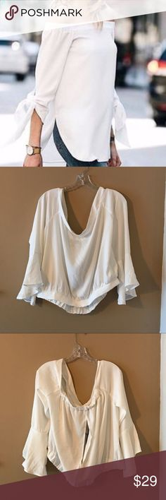 NWT iJeans by Buffalo Off Shoulder White Top XL This is a stunning top! Shoulders are cut out. Open back cutout. Adorable bell sleeves. Elastic waist band. Firm price unless bundled. First pic is a stock image to show fit. iJeans By Buffalo Tops Blouses