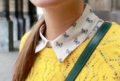 bright yellow sweater on butterfly print collar.