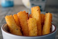 Polenta fries are boiled corn meal until it gets thick.  It is put in a greased pan and chilled.  It is cut and pan fried.  It is a hearty alternative to french fries.