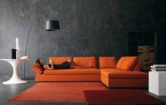 Pantone Tangerine Tango looks superbly vibrant in this top to bottom gray room...    Via http://www.beinteriordecorator.com