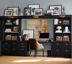 Black built-in shelving and brass hardware gives this home office suite maximum organization and style.