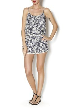 Floral print romper in navy with white pattern