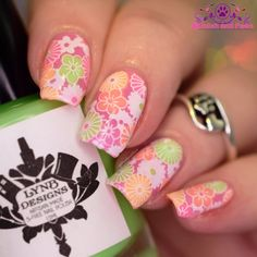 Reverse Stamping Floral Nail Art by PolishandPaws