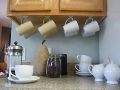 Hanging coffee mugs... easily accesible and off the counter ...
