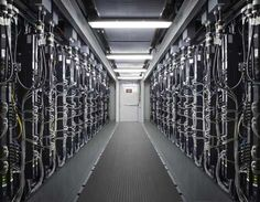 HP EcoPOD Modular Design via Rich Miller: A look inside the hot aisle in a new HP EcoPOD modular data center, which joins two 40-foot enclosures to create a wider server room.