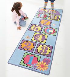 This Hopscotch Mat is much better than the chalk one my sister and I drew in the garage.. or is it?
