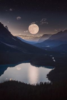 A moonrise over a mystical mountain landscape. Very beautiful                                                                                                                                                                                 More