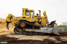 Cateripillar A bulldozer at a mulching complex. Welding Courses, Dump Trucks, Education And Training, Training Center, Military Vehicles, Transportation, Stock Photos, Pictures, Caterpillar