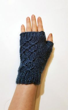 These easy smocked mitts by Budget Knitting make a great (and affordable!) gift! Made with just one ball of Lion Brand Heartland!