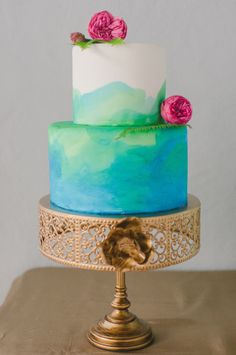 Green and blue wedding cake: http://www.stylemepretty.com/pennsylvania-weddings/philadelphia/2014/05/29/winter-to-spring-wedding-inspiration/ | Photography: Rachel Pearlman - http://www.rachelpearlmanphotography.com