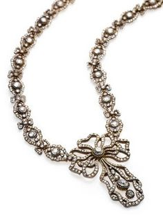 An early 20th century diamond necklace, Cartier, 1906, signed Cartier Paris, numbered, mounted in silver topped gold. This elegant necklace, entered into Cartier stock in Paris in 1906, is rare. It represents an important time of transition for the esteemed house of Cartier. In fact, the date of creation coincides with an important metamorphosis the established house of Cartier underwent at the very beginning of the 20th century.