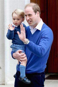 The Duke of Cambridge and Prince George wave outside the hospital where is new sister has just been born!