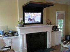 Hiding A Flat Panel Tv Above Fireplace Traditional Living Room Orange County