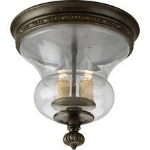 View the Progress Lighting P3815 Fiorentino Two-Light Flush Mount Ceiling Fixture with Clear Seeded Glass Shade and Champagne Drip Glass Candles at LightingDirect.com.