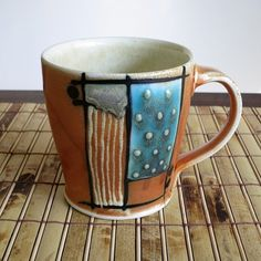 MDPottery - Salt Fired Porcelain Coffee Cup. Flashing slip, slip trailed design. Glaze and underglaze.