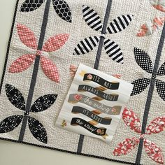 Love the B+W+Red color theme of this baby quilt (pattern available in Vintage Vibe book by Gigi's Thimble)