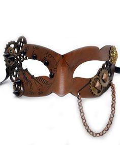 Венецианская маска классической формы выполнена в Steampunk стиле. Держится карнавальная маска на лентах. Купить её можно в интернет-магазине http://fas.st/Y3XxO