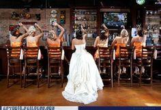 bride and bridesmaids drinking at bar
