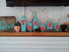 Painted bottles and old wood ,pinecones from yard , makes a great Thanksgiving decoration.