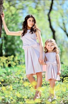Mother - Daughter Style | Vişne Tadında Nude Dresses Cute Bow Tiny Jewels Orange High Heels Comfortable Silver Shoes Fashion Shoot Spring-Summer Outfit Ideas Sun  Curly Fair Hair Brad Back Stages Smile Happy Childhood Sisterhood Hands Together Pink Flowers Hot Weather www.visnetadinda.com Cansın Ekşi