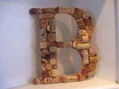 Keepsake gift for the bride: the initial of her new last name made from wine corks :-)