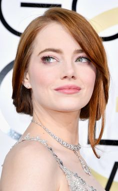 Emma Stone from 2017 Golden Globes' Best Beauty Looks  Pale pink looked demure against the actress' cool skin tone.