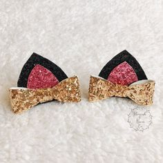 Are you kitten me right meow?! This adorable kitty cat hair clips are the perfect accessory for any kitty cat lover! This listing is for 2 cat ear clips with glitter black ears, glitter pink center, and a glitter gold bow (as pictured). If you would like to personalize you cat ears, please message