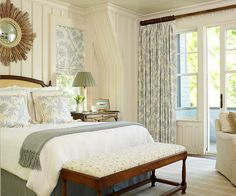 Open Space A wall of windows and access to a patio ensure this bright room is never short on natural light. Classically styled furniture echoes the cozy cottage character of the room, while dark wood finishes add contrast to white walls and neutral linens. A soft botanical fabric featured on throw pillows and window treatments add a dash of pattern to this mostly white space.