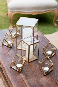 Wedding lounge centrepiece of gold geometric candleholders via Liesl Cheney Photography / http://www.deerpearlflowers.com/terrarium-geometric-details-ideas/4/