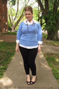 Plus-size work wear  |  White button up, light blue sweater, black skinny slacks, peep-toe kitten heels.