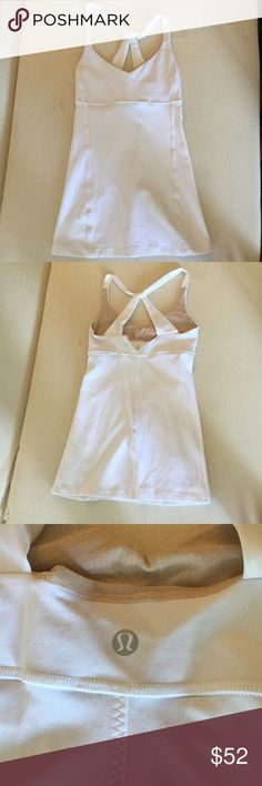 Lululemon White Practice Daily Tank Top size 4 NWOT white with beige lining on the bust - happy to include pads/cups if you request it. Such a flattering cut! I have this top in 3 other colors but don't often wear white, so it's been sitting in my closet not getting as much love as the other three. It needs a better home! lululemon athletica Tops Tank Tops