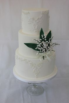 Elizabeth Taylor inspired Wedding Cake with bespoke piped lace pattern, sugar pearls, and sugar Lily of the Valley.