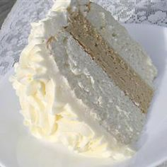 "White Almond Wedding Cake Recipe - A secret ingredient of sour cream makes this cake so moist, dense, and delicious!"" .. I'm going to try this recipe to make cupcakes for my friend's wedding shower:)"