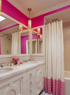 Pop of pink.  Color your mornings by painting the bathroom a vibrant hue.  This neutral palette with the white cabinets, marble top and light tile is a perfect compliment to the punch of paint.  We all love a little morning cheer.