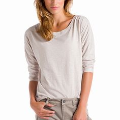 Our drop-shoulder, scoop-bottom top feels good all over in our Organic Cotton. This fabric gives it a shot of eco chic. Long sleeves Drop shoulders Scoop bottom Length: 26 in./66 cm