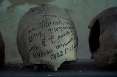 Bulgaria - Eerie inscribed skulls of dead monks line the crypt of Preobrazhenski monastery at Veliko Tarnovo in Bulgaria, also known as the Transfiguration monastery.