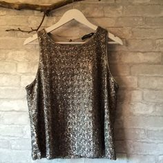 Sequinned tank Silver Sequinned tank.   I am a top-rated seller and fast-shipper .                                       No trades. Please use the offer button to submit offers Forever 21 Tops Tank Tops