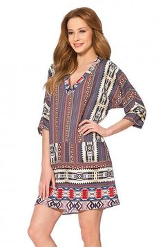Beautiful V-neck tunic for summer, in woven fabric with a oriental print. This dress fits perfect to different events.