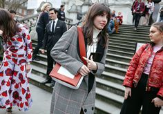 Kat Collings in Lanvin coat, Jacquemus sweater and with a Céline bag