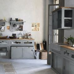 pretty grey cabinets with butcherblock countertops, pull in the medium color wood floors and do a very light neutral wall color (warm white?) - gorgeous