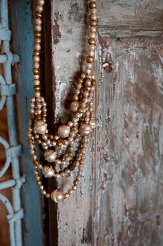 Handmade by artisans in Ethiopia. The beads are made from items including weapons from past conflicts.
