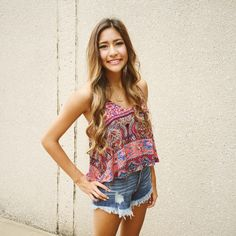 You can never go wrong with a crop top and jean shorts! To order, call us at 4794342318!