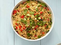 Cold Peanut Noodle Salad:  Cook 1 pound Chinese egg noodles; drain and rinse.  Whisk 1/2 cup peanut butter, 3 tbsps. each of soy sauce, Sriracha and rice vinegar, and 1 tbsp. each of sesame oil and grated peeled ginger.  Toss with the noddles, 1 each of chopped red bell pepper and cucumber, and 1/2 cup of chopped cilantro; season with salt and pepper.  Serve slightly chilled or at room temperature.
