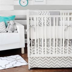 Love this mixed pattern nursery in gray with pops of teal!