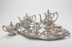 """Reed & Barton, Taunton, MA  Sterling silver FRANCIS I five-piece tea and coffee service with two-handled matching tray (30x23 in.), hand chased coffee pot, (10 3/4"""") teapot (8 1/4""""), two-handled and lidded sugar bow, cream jug and waste bowl, pattern #570A, total 6 pieces #sliver #decorativearts   www.linkauctiongalleries.com Francis I, Coffee Service, Reed & Barton, Teapot, Art Decor, Tray, Auction, Bow, Sugar"""