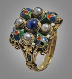 HENRY GEORGE MURPHY 1884-1939 Superb Gothic Arts and Crafts Ring with Celtic and Medieval influences Gold Enamel Sapphire Pearl H: 1.5 cm (0.59 in) British, 1929