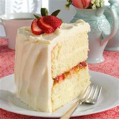 Vanilla Bean Cake with White Chocolate Ganache Recipe -For a distinctive dessert with unforgettable flavor, I recommend this cake. Feel free to substitute your favorite jam and lend your own touch to this signature treat. —Lisa Bogar, Coventry, Vermont